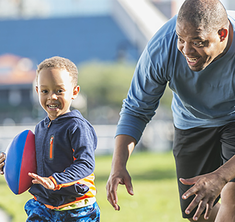 man playing with young son