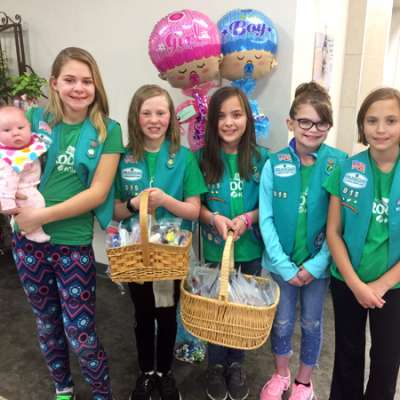 Girl Scouts with hat donations
